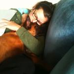 KatyK9 cuddles a puppy